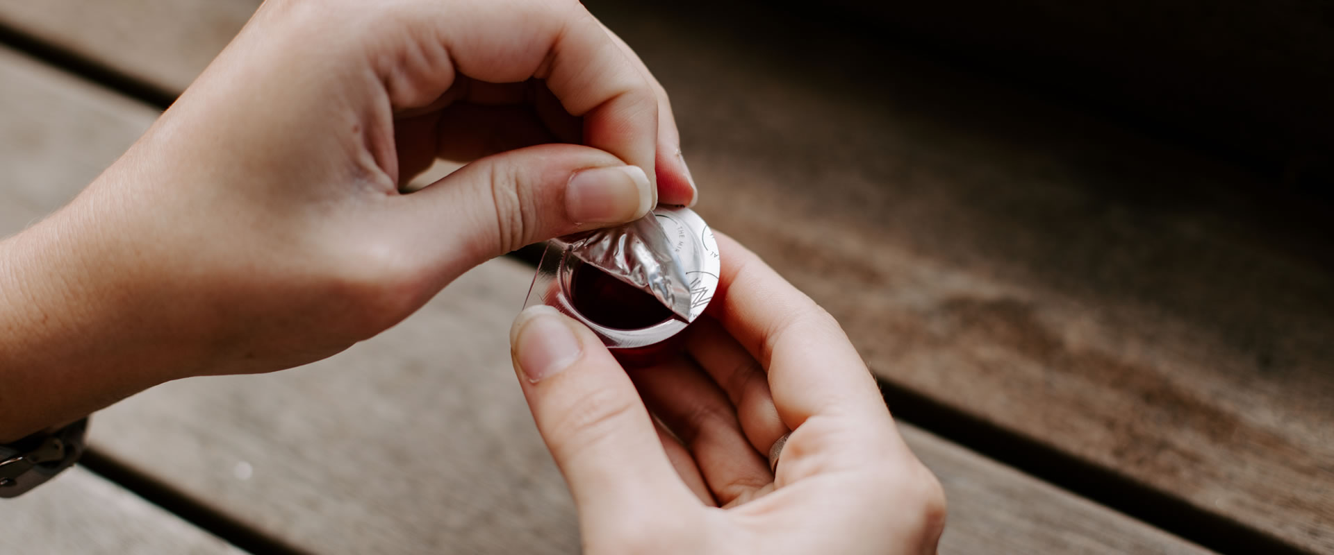 Peeling open the pre filled communion cup